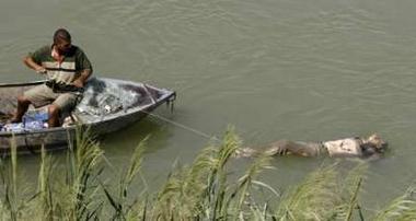 Pollution in the Tigris, dead body